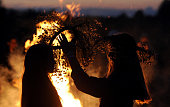 TOPSHOT Two girls put traditional wreaths near a bonfire as they take part in the Ivan Kupala Night celebration a traditional Slavic holiday outside...