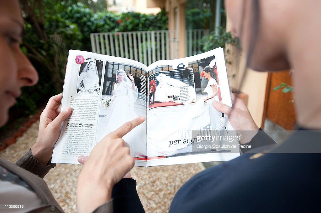 Two girls read an Italian magazine showing photographs of Prince William, Duke of Cambridge and Catherine, Duchess of Cambridge following their wedding, on May 3, 2011 in Rome, Italy. The marriage of the second in line to the British throne was led by the Archbishop of Canterbury and was attended by 1900 guests, including foreign Royal family members and heads of state. Thousands of well-wishers from around the world flocked to London to witness the spectacle and pageantry of the Royal Wedding.