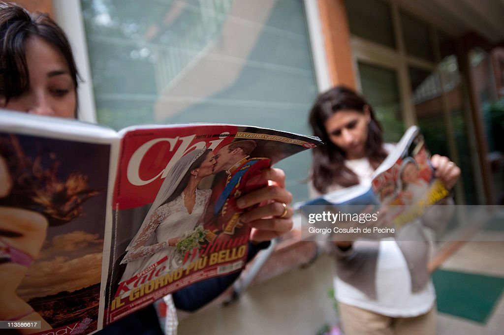 Two girls read Italian magazines showing photographs of Prince William, Duke of Cambridge and Catherine, Duchess of Cambridge following their wedding, on May 3, 2011 in Rome, Italy. The marriage of the second in line to the British throne was led by the Archbishop of Canterbury and was attended by 1900 guests, including foreign Royal family members and heads of state. Thousands of well-wishers from around the world flocked to London to witness the spectacle and pageantry of the Royal Wedding.
