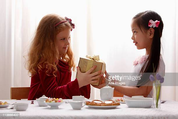 two girls sharing a gift