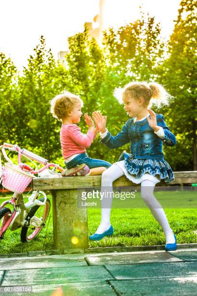 Two girls sitting on bench