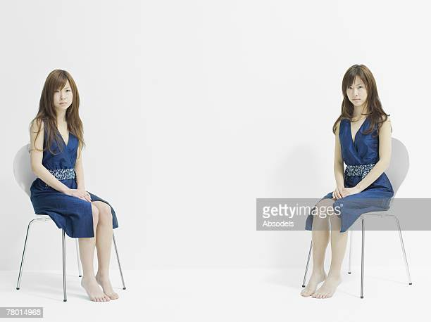 Two girls sitting on chair
