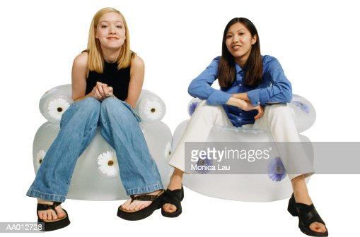 Chairs For Teenage Girls two girls sitting on inflatable chairs stock photo | getty images