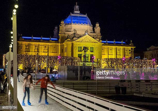 Two girls skate at the ice rink in the city centre on December 22 2015 in Zagreb Croatia Zagreb was voted last week European Christmas Market of the...