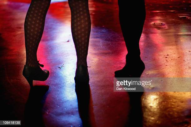 Two girls stand on the dance floor to watch a band at the 100 Club on February 24 2011 in London England Since it's opening in 1942 the 100 club has...