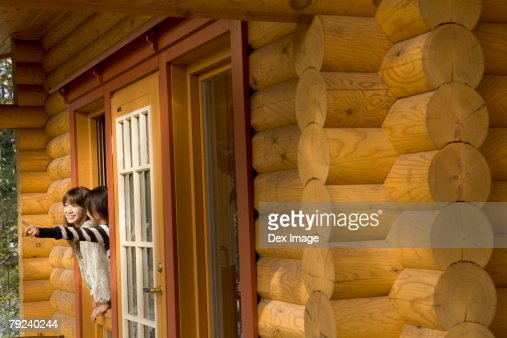 Two girls staring out of a cabin's window : Stock Photo