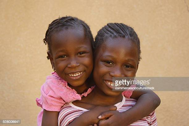 Two girls together smiling