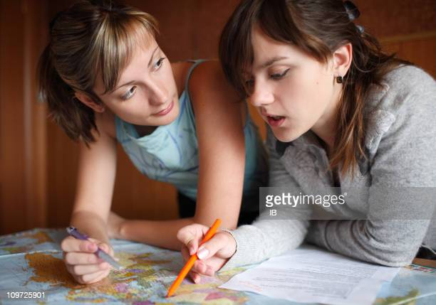 Two girls watching the map