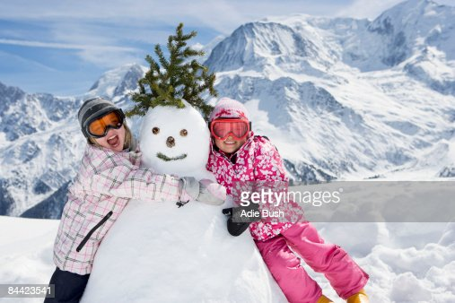 Two girls with a snowman