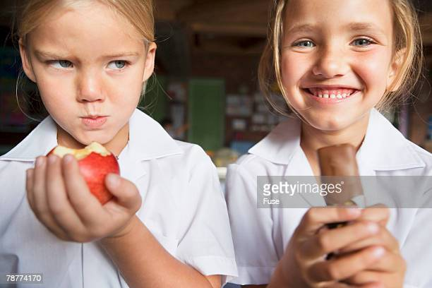 Two Girls with Apple and Chocolate
