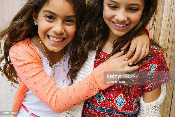 Two girls with arms around each other