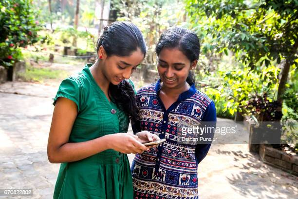 Two girls with cellphone
