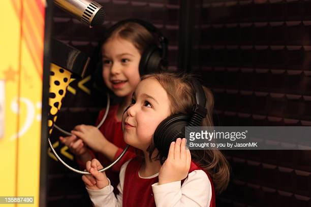 Two girls with headphones