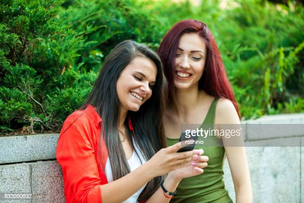 Two girls with phone