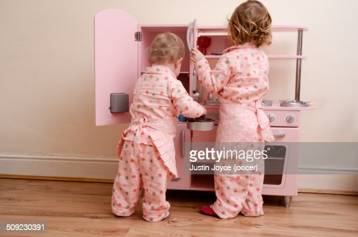 Two girls with play kitchen stock photo getty images for Xnxx in the kitchen