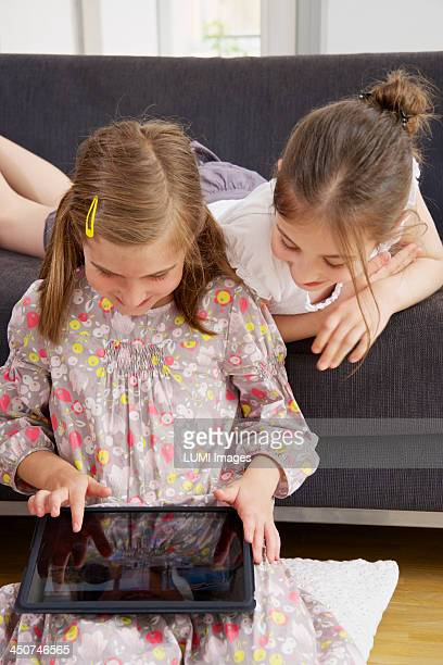 Two girls (10-12) with tablet pc, Munich, Germany