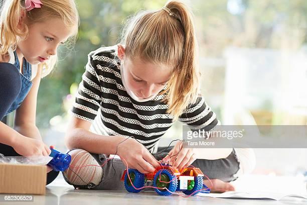 two girls working on robotics