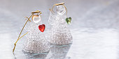 Two glass angels with hearts on the table.