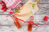 Two glass bottles of homemade rhubarb juice