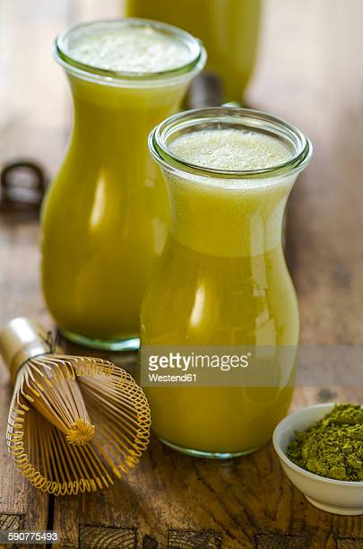 Two glass bottles of matcha smoothie