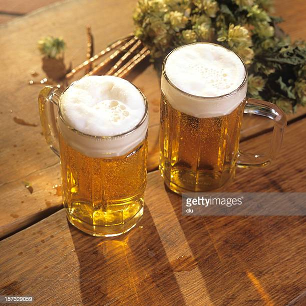 Two glasses of beer with hops