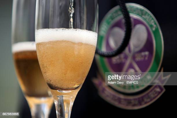 Two glasses of champagne sit in front of the wimbledon logo