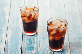 Two glasses of cold cola