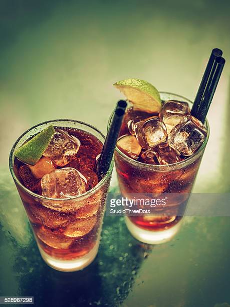 Two glasses of cold rum cola