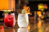 Two glasses of frozen lemonade on bar counterTwo glasses of frozen lemonade on bar counter