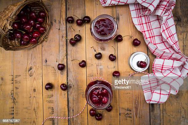 Two glasses of homemade cherry groats and cherries on wood