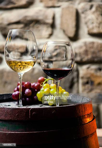 Two glasses of red and white wine in the cellar
