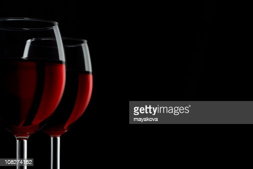 Two Glasses of Red Wine isolated on black background : Stock Photo