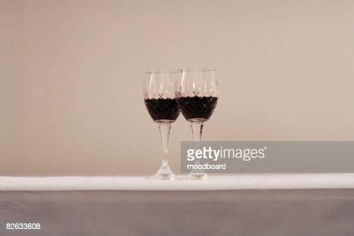 Two glasses of red wine on table : Stock Photo
