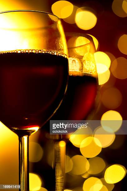 Two glasses of red wine with blurred light background