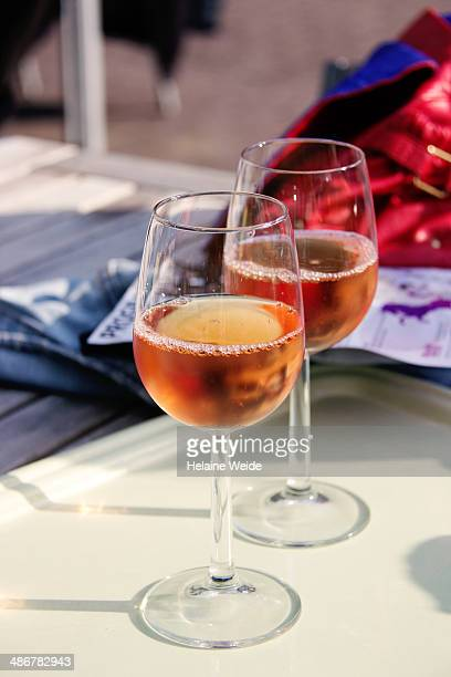 Two glasses of rose wine on a table