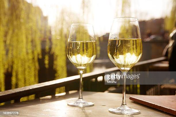 Two glasses of white wine against the sunlight
