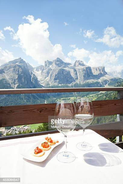 Two glasses of white wine with mountain in summer