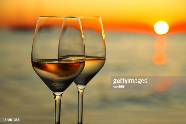 Two glasses of wine and beautiful sunset