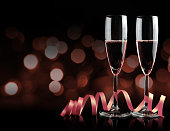 Two glasses with champagne and ribbon. New Year Celebration.