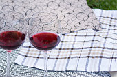 Two glasses with red wine on a beautiful tablecloth. Top view, closeup of alcoholic drink.