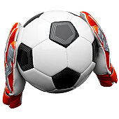 Two goal keepers gloves holding a football