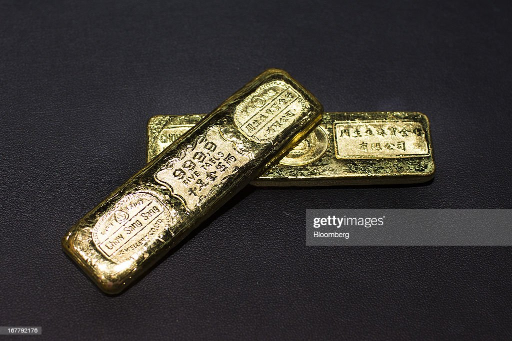 Two gold bars, each weighing five taels (187 grams), are arranged for a photograph at a Chow Sang Sang Holdings International Ltd. jewelry store in the Mongkok district of Hong Kong, China, on Tuesday, April 30, 2013. Chow Sang Sang said that jewelry sales at its 44 shops in Hong Kong more than doubled in the two weeks ended April 27 from a year ago. Photographer: Lam Yik Fei/Bloomberg via Getty Images