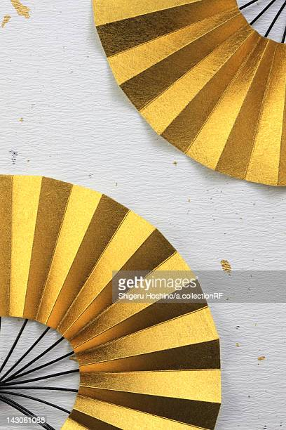 Two golden Japanese fans