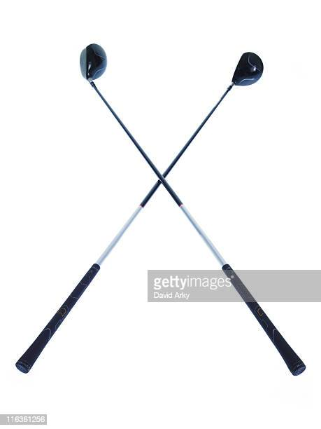 Two golf clubs on white background