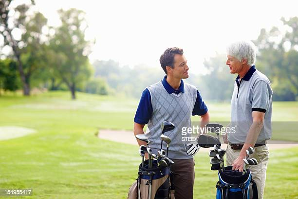 Two golfers in discussion