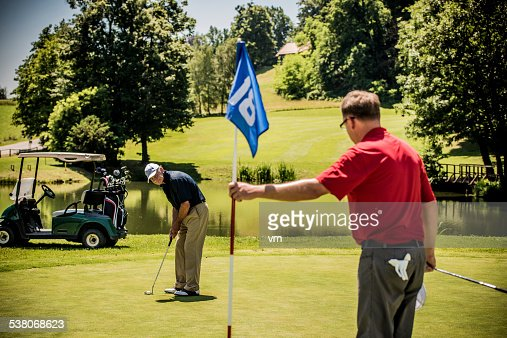 Two Golfers on Putting Green