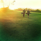 Two golfers walking on golf course