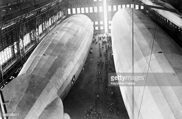 Two Graf Zeppelin airships inside warehouses at Lakehurst airfield in 1928 in the United States