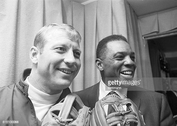 Two great fieldersluggers Mickey Mantle of the New York Yankees and Willie Mays of the San Francisco Giants display a couple of mitts at the Sporting...