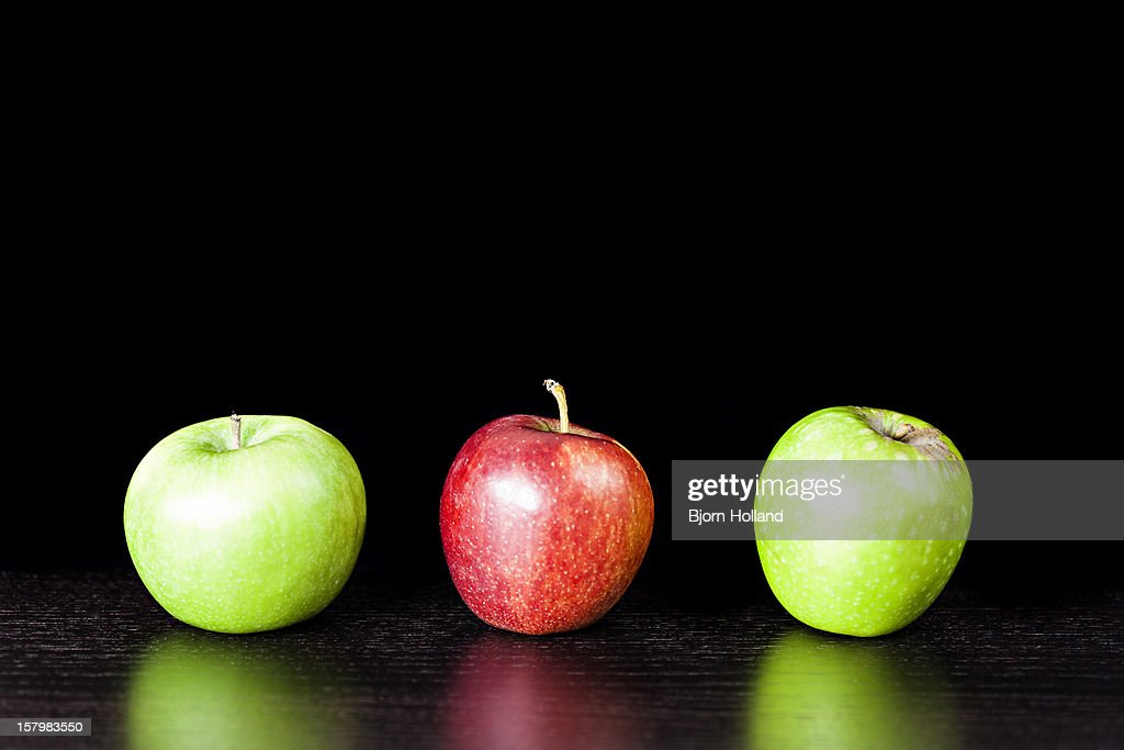 Two green and one red apple : Stock Photo
